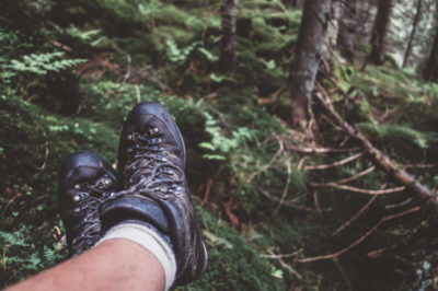 Man legs in hiking boots