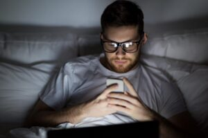 Copy of man-with-laptop-and-smartphone-at-night-in-bed-P6AWWCK72