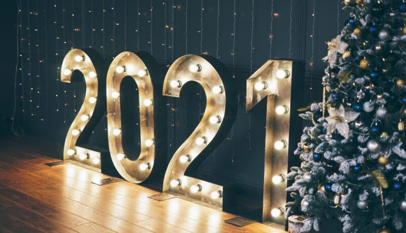 Copy of glowing-numbers-2021-on-a-dark-wall-background-dec-JDUC69K72